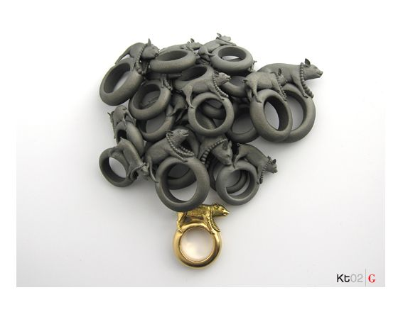 Avondvlinder by Ted Noten: Noten's 3D printed jewelry.. These piggies in pearls were 3D printed in titanium and gold.