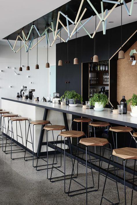Tuckbox Design custom stools at Cafe LaFayette, Port Melbourne Barra con extensión. Banquetas hierro y madera