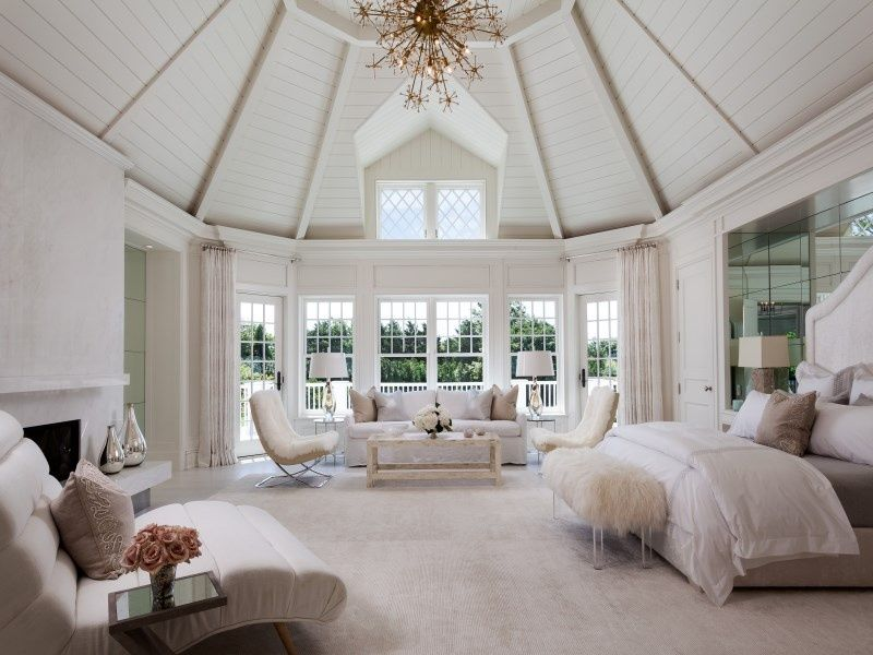 Cottage Master Bedroom with Cement fireplace Chandelier