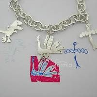 Turn your child's art into jewelry at http://www.formiadesign.com/product/charm/