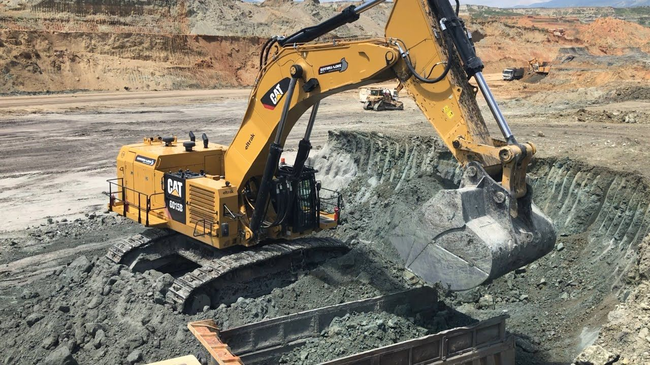 Cat 6015b excavator loading trucks with two passes