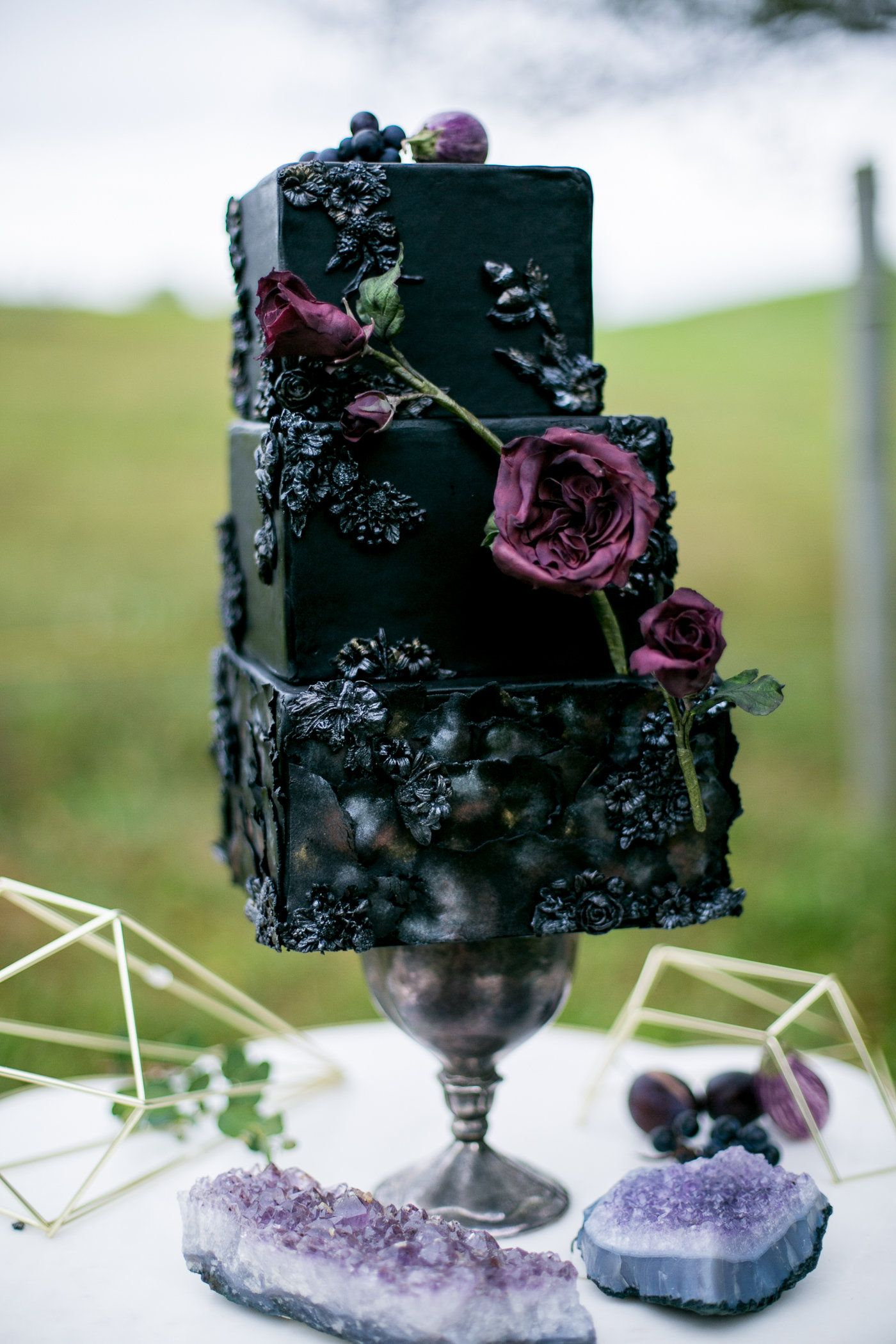 Black and plum wedding cake with texture and sugar flowers