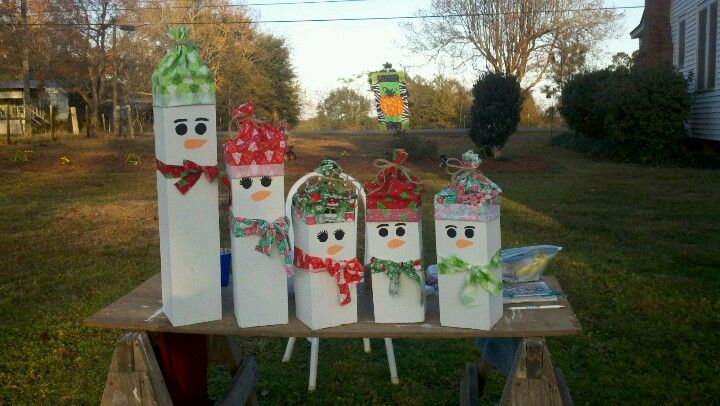 Snowmen. 6x6, paint, and fabric is all you need! I used exterior paint and 1 foot of each fabric. Tied hats with twine.
