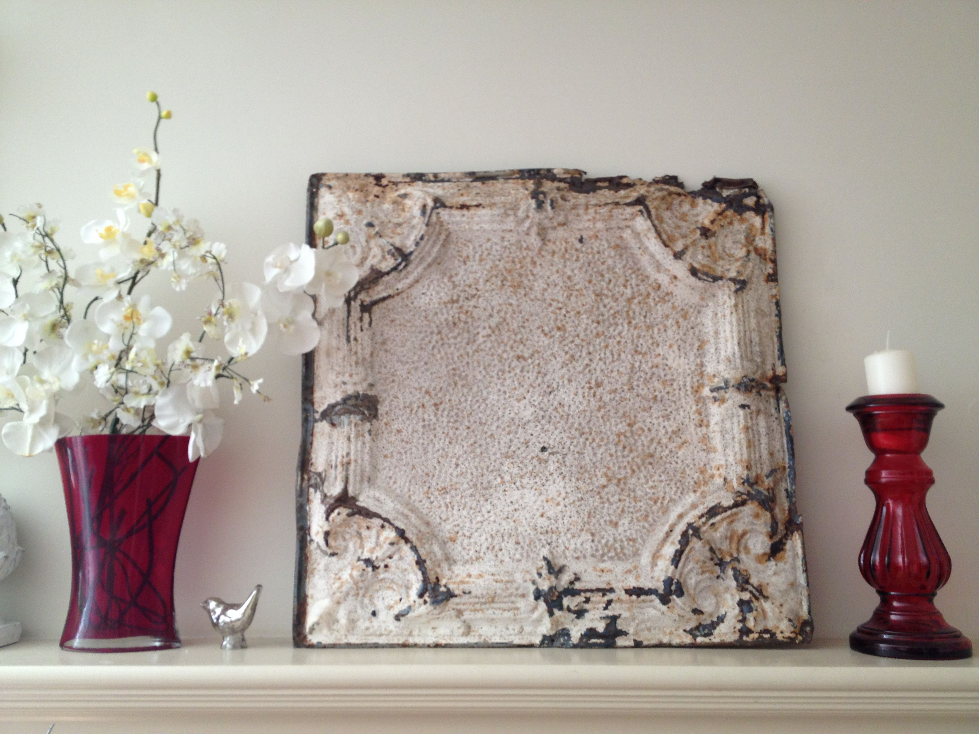 My mantle with an antique ceiling tile that i purchased from the my mantle with an antique ceiling tile that i purchased from the antique mall in agoura doublecrazyfo Choice Image