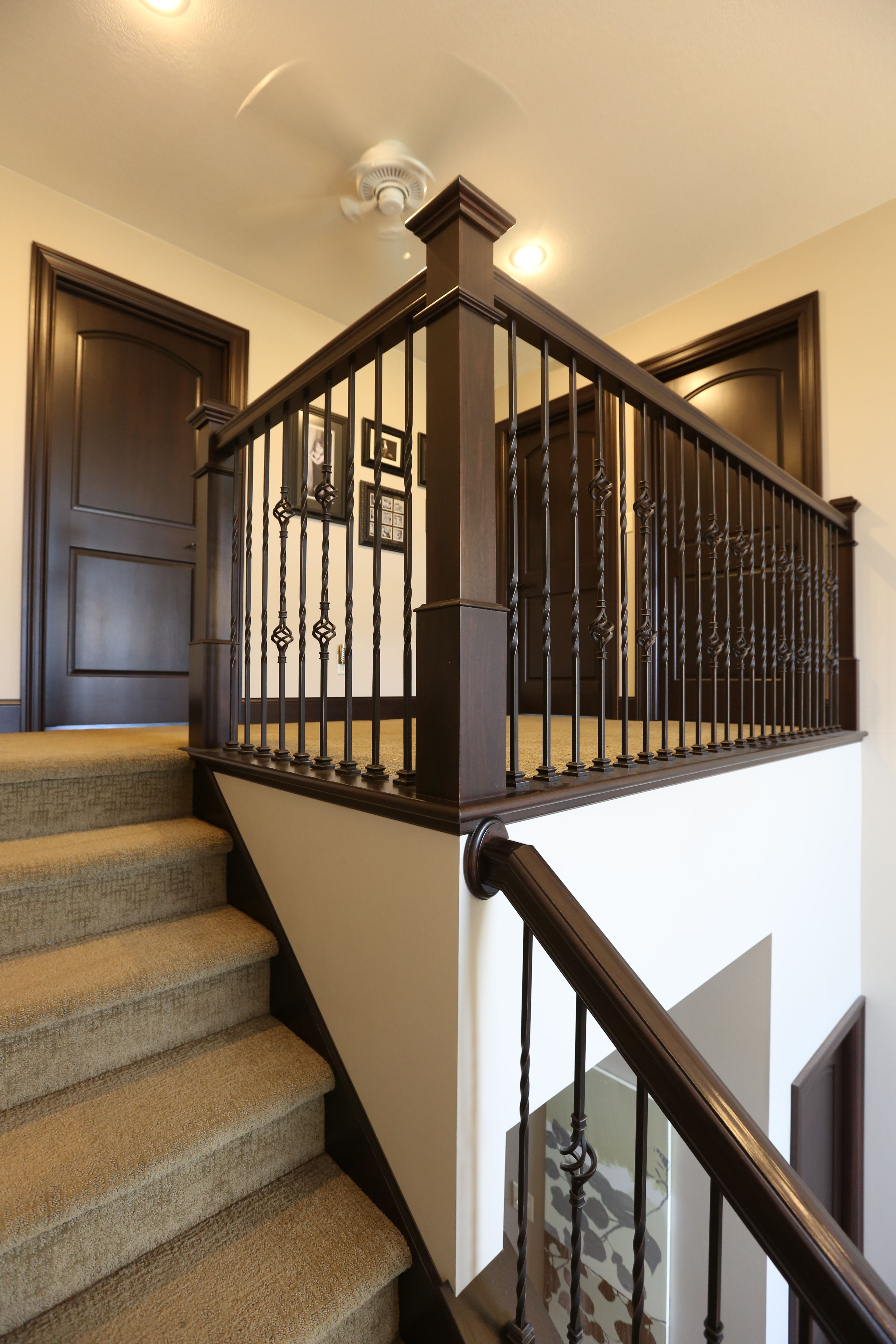 Stair Systems | Dark Stain, With Wrought Iron Balusters | Bayer Built  Woodworks, Inc