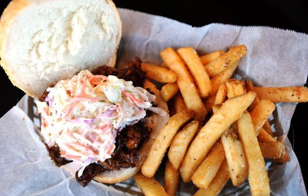 This is the 'Local Stryker Farm BBQ Pulled Pork Sandwich' with homemade Coleslaw and Boardwalk style fries served at the Steel Pub in Bethlehem.