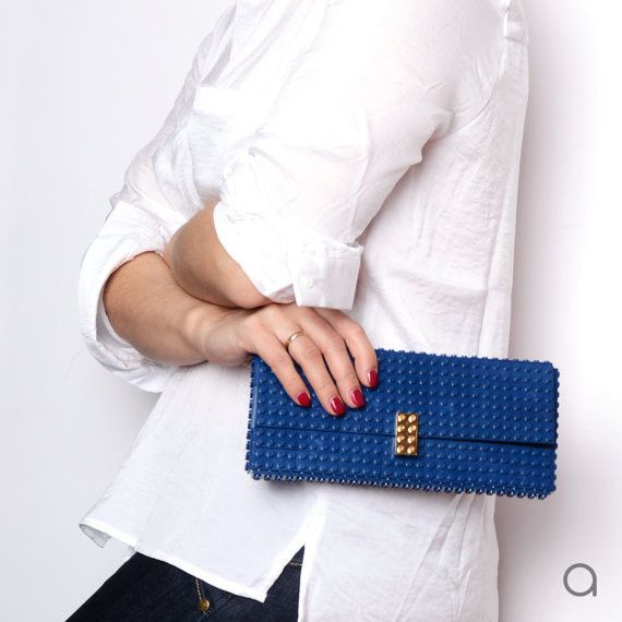 47d0f16e64 Elevate evening looks with this black or dark blue AGABAG clutch. It has  gold plated elements made entirely with LEGO bricks. Style yours with a  dress, ...