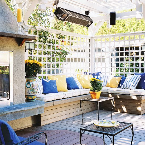 A corner bench is a space-savvy way to provide seating for guests. More seating solutions for your patio: http://www.bhg.com/home-improvement/deck/ideas/outdoor-seating/?socsrc=bhgpin061412
