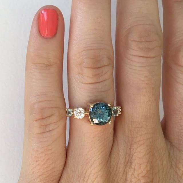 1173a3e2e 2.10 carat blue-green Montana Sapphire. Flanked with an old mine cut  diamond, aqua and Montana sapphire. Mociun
