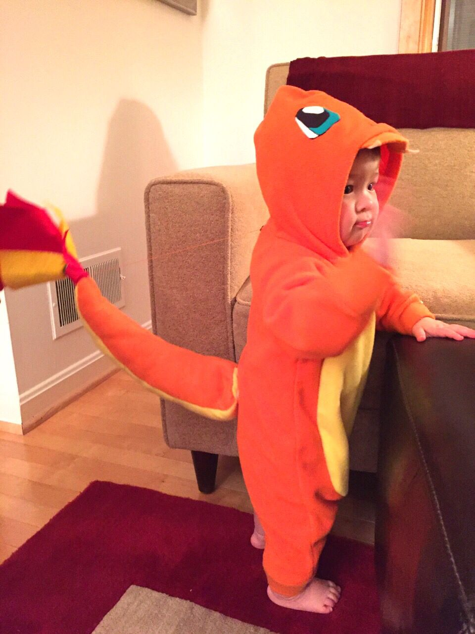 grandma made alex her 1st halloween costume - charmander from