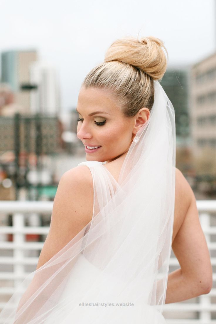 lovely chic bridal hairstyle, high bun, long veil, elegant