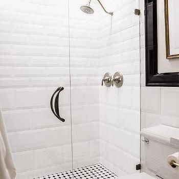 black and white walk in shower with glossy white beveled