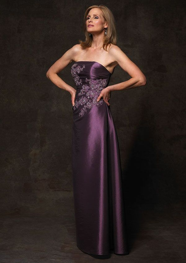 Jean De Lys 29215 This strapless gown has slight ruching on the sides and beaded floral appliqu?s throughout he bodice. It is paired with a lace bolero that has 3/4-length sleeves.Fabric:Taffeta #timelesstreasure