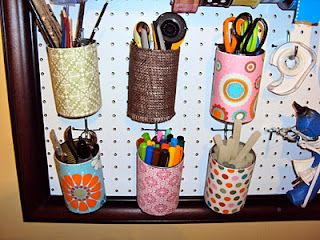 Punch a hole in the back of them near the top so they can hang from your peg hooks.