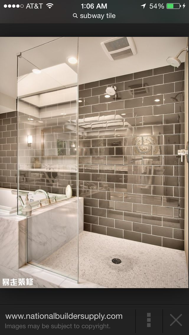 Love this gray color too  the partial glass wall also contemporary shower boasts  subway tiled ceiling and walls