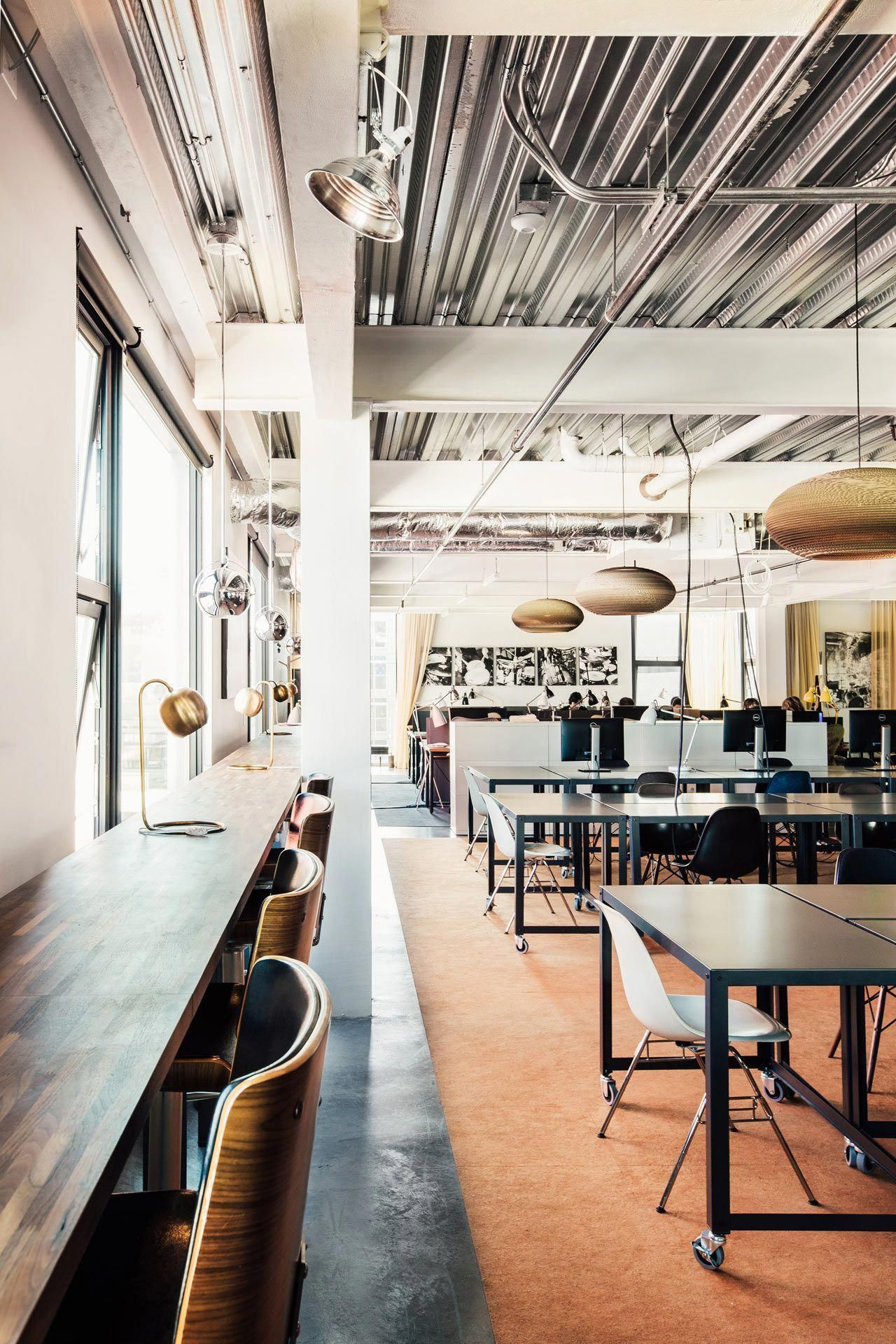 Modern Industrial Office Space With Black Furniture And Warm