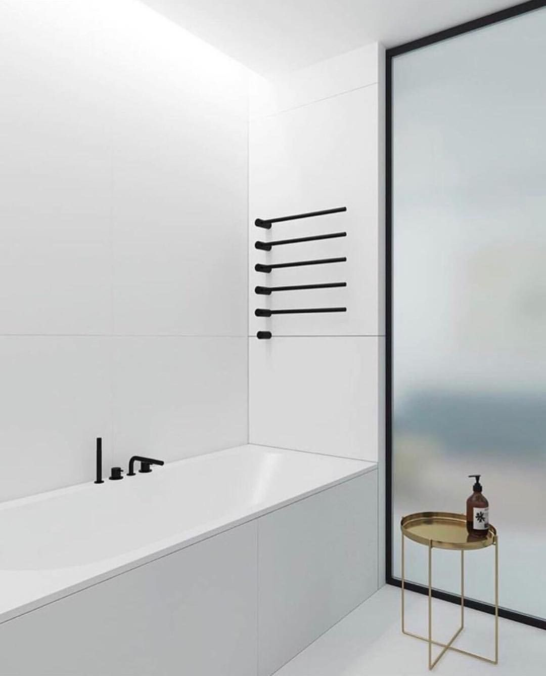 Minimalist Bathroom Vola Heated Towel Rail Image Via