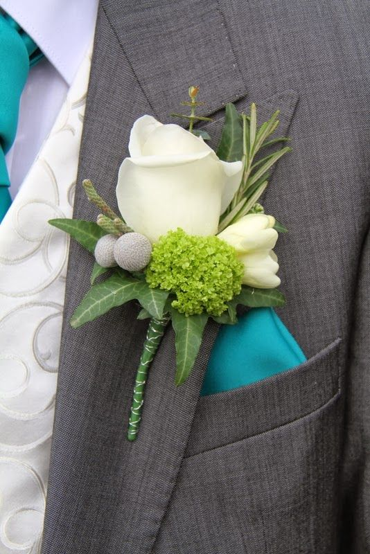 he Bride Groom's Boutonniere included a sprig fresh Rosemary with an Akito Rose, Florets of White Freesia, Albiflora, Viburnum Opulus and Eucalyptus