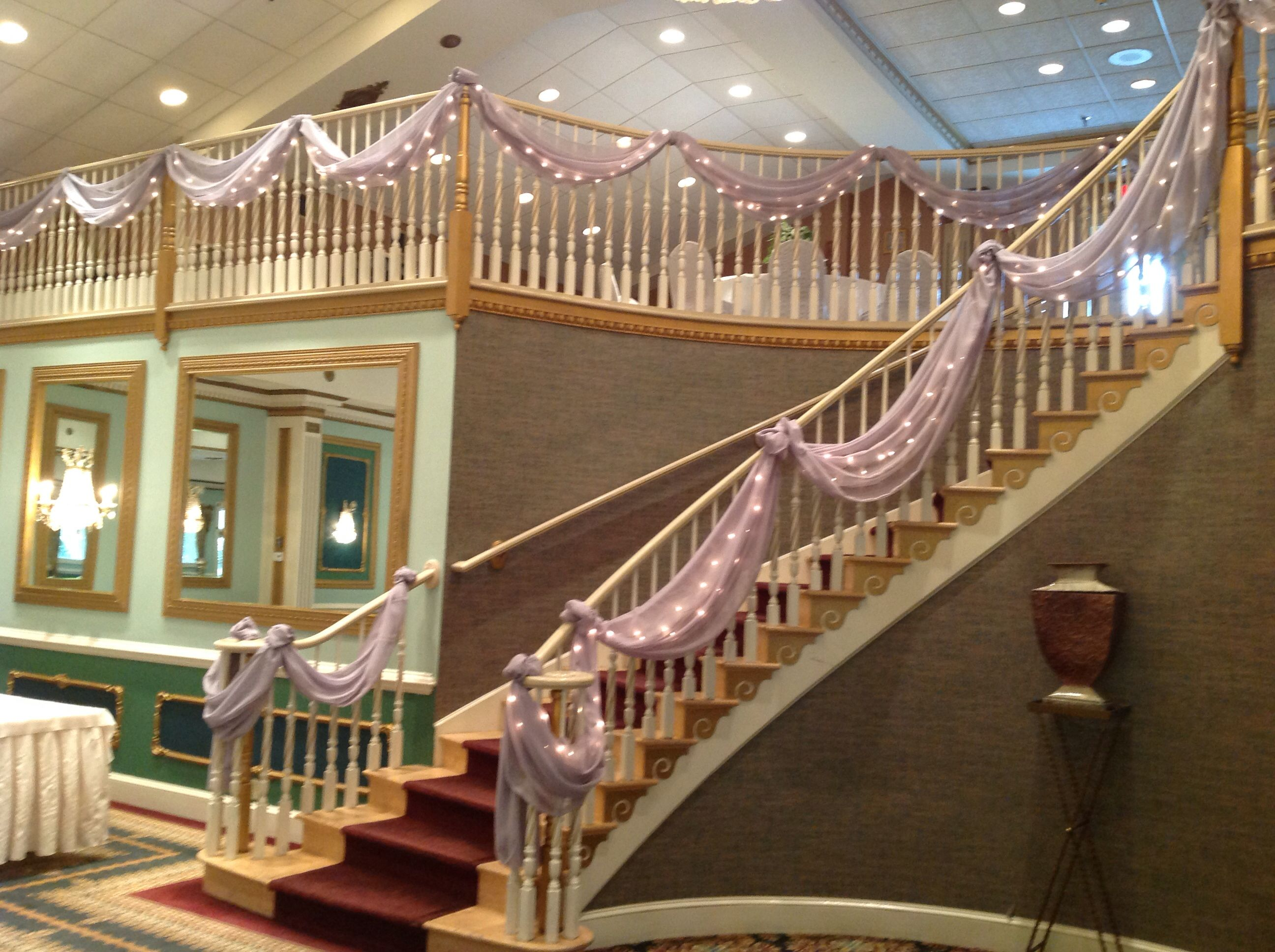 The Staircase At Mendenhall Inns Grand Ballroom Decorated With Material And Lights By Ramones Flowers