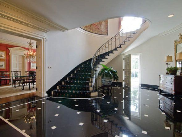 A Grand Foyer With Black Marble Floors Repinned By Anna Marie