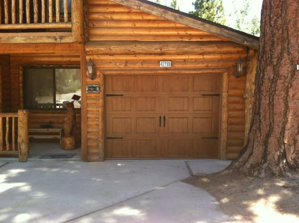Clopay Gallery Collection Steel Garage Door With Medium Ultragrain Finish Installed By Kings On This Log Cabin Home
