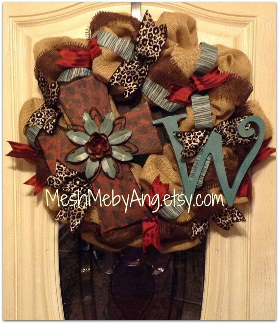 Burap tan wreath, red and teal cross with brown frayed ribbon thoughout, and custom inital on Etsy, $75.00