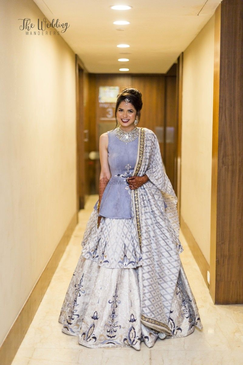 Lovely layered lehenga in pastel blue and white with a peplum styled