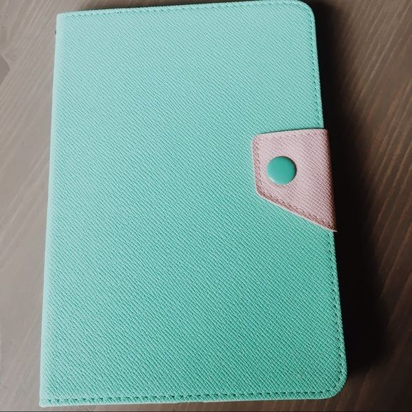 IPad mini case in Blush & Mint IPad mini case in excellent used condition! Material is vegan leather in blush and mint colors. Closes with magnetic clasp. Inside rubber in excellent shape. Holds iPad in place extremely well. Ordered off Etsy shop about 2 years ago. Accessories Tablet Cases