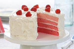 Ombre Cake- Made by adding colourful layers, sweet vanilla icing and fresh raspberries to our Irresistibly Easy White Cake. One bite of Ombre Cake will have you over the moon.