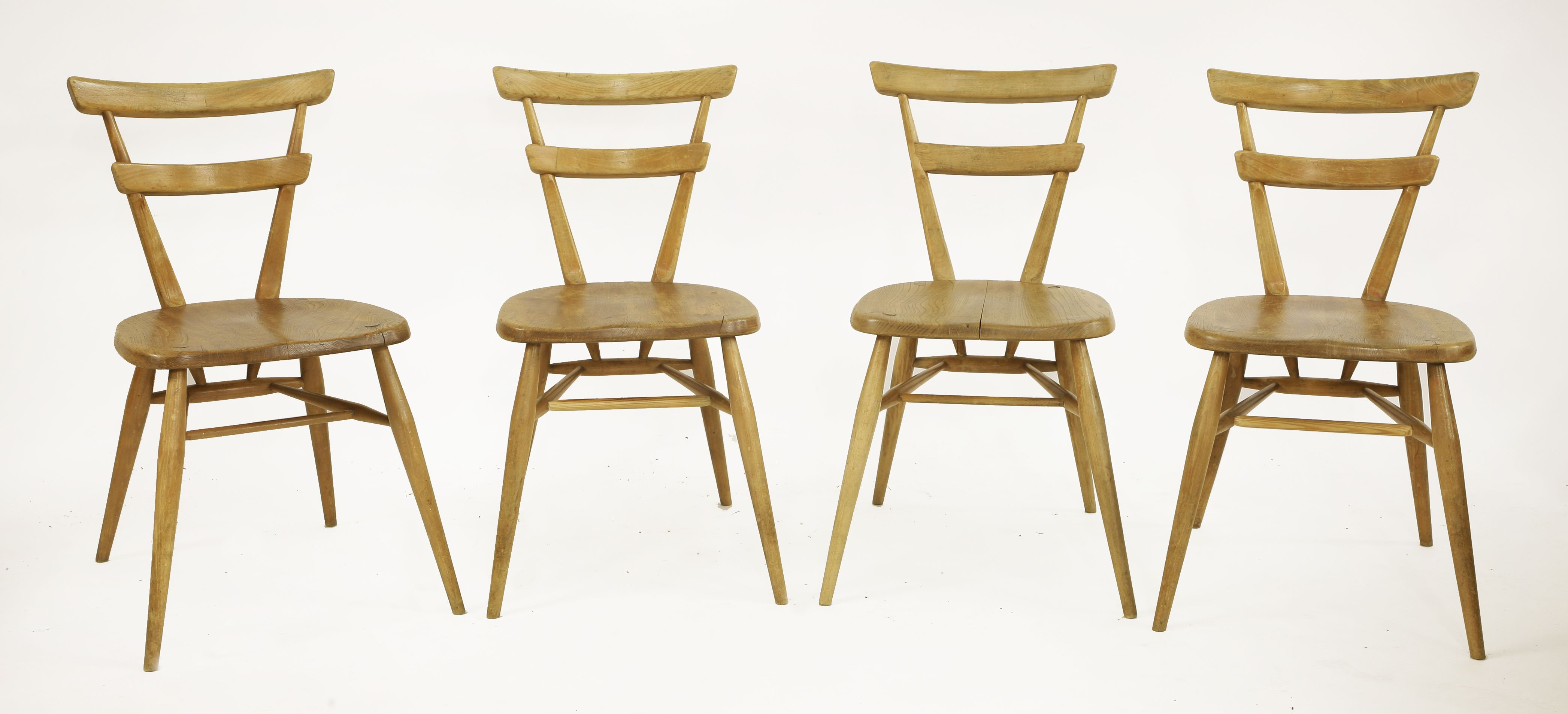 Four Ercol stacking chairs, green dot, Sold for £300 on