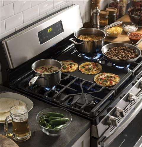 upgrade to a gas range like this one from ge that features a center griddle cool things to buy appliances gas range pinterest