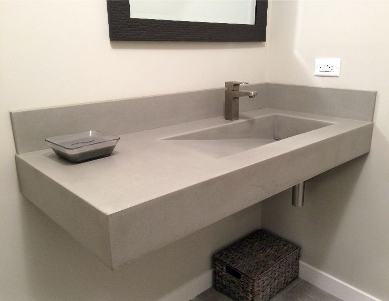 CUSTOM LAVATORY (see Copper Undercount Sink Below) AND BUILT IN COUNTERTOP:  Concrete Sinks
