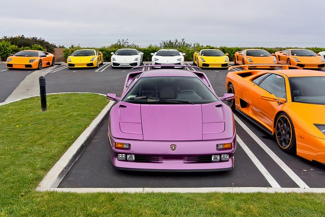 Mucho Diablos  {It might be lavender -- but it's a Lamborghini.  Are those taxi cabs around it?}
