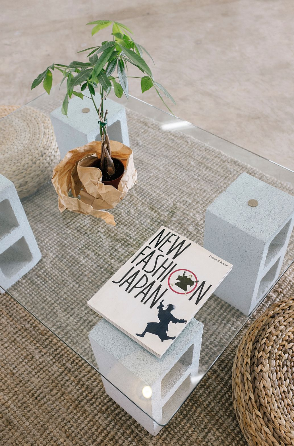 Create a coffee table with some painted cinderblocks a piece of