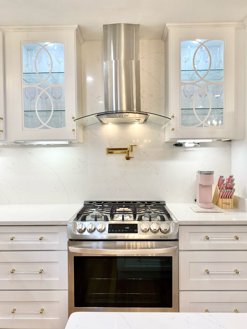 Golda Of Pretty Twinkle Design Reveals Her White And Gold Kitchen Featuring Schaub S Lumiere Transitional Acry In 2020 Gold Kitchen Kitchen Renovation Acrylic Cabinets