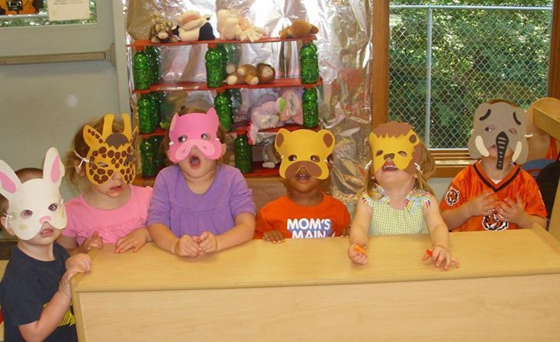 Preschoolers from KinderCare are having a great time with some animal masks.  Play is an important part of the learning process.