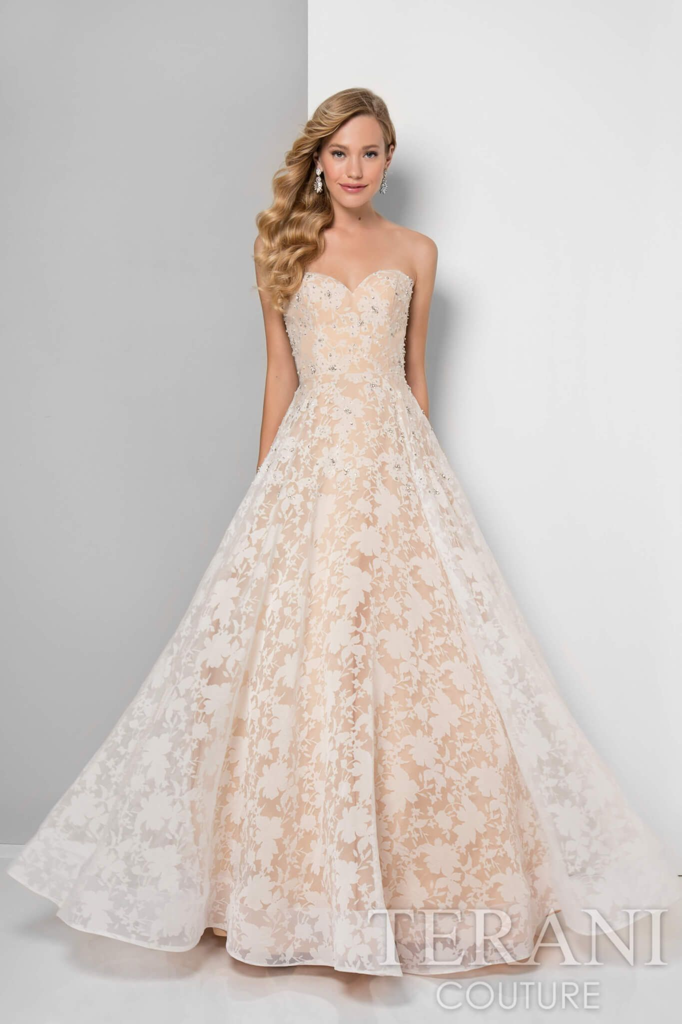 Designer prom gown in transparent organza that is covered with an