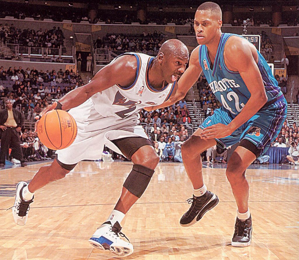 Michael Jordan drives past PJ Brown Rare NBA s