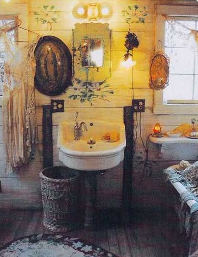 A sweet boho bathroom - this looks like the type of bathroom that doesn't need to be spotless. Eclectic and cave like. Me likey.