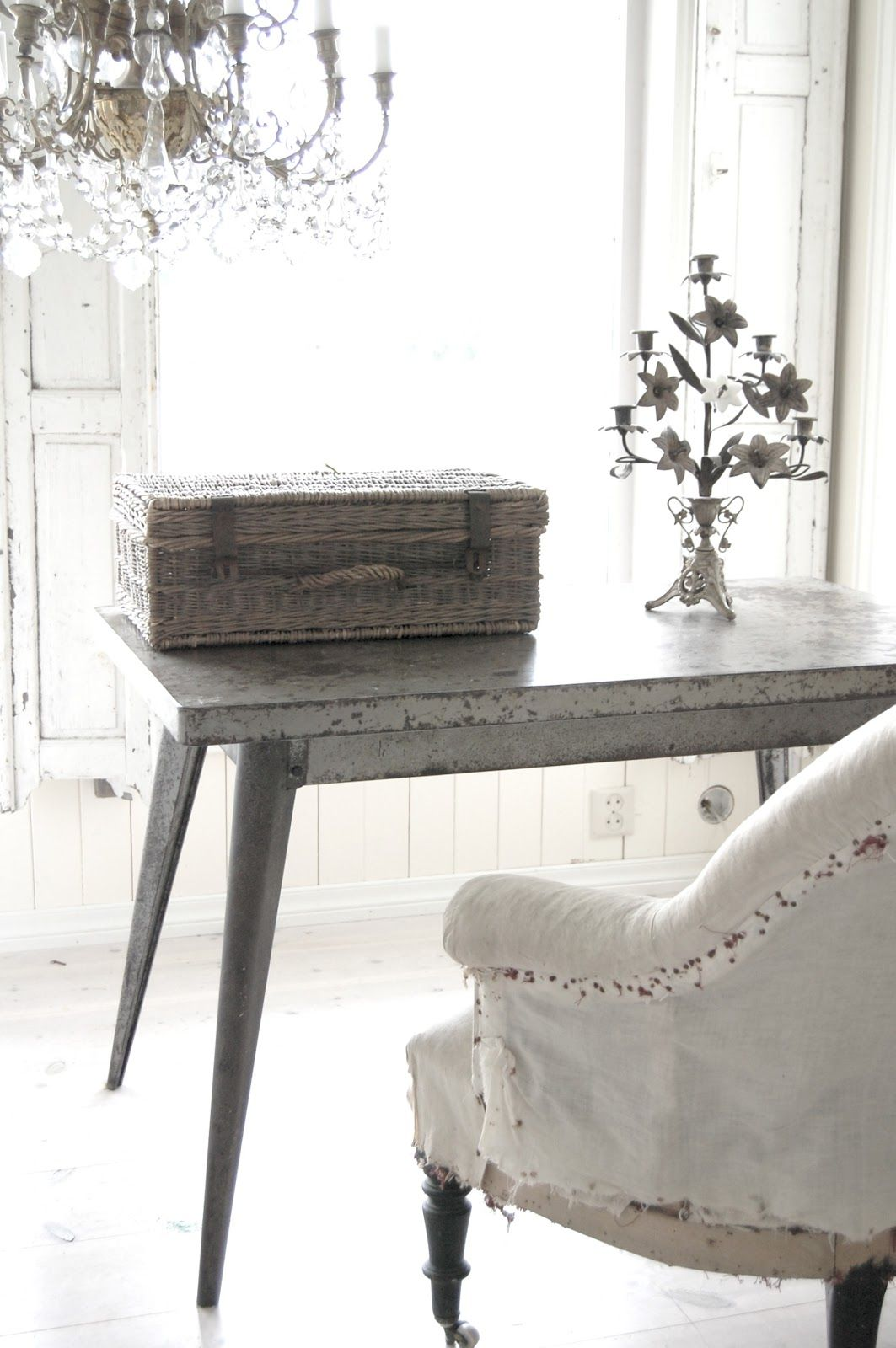 Love all of the items here...from the elegant chandelier to the tattered chair.