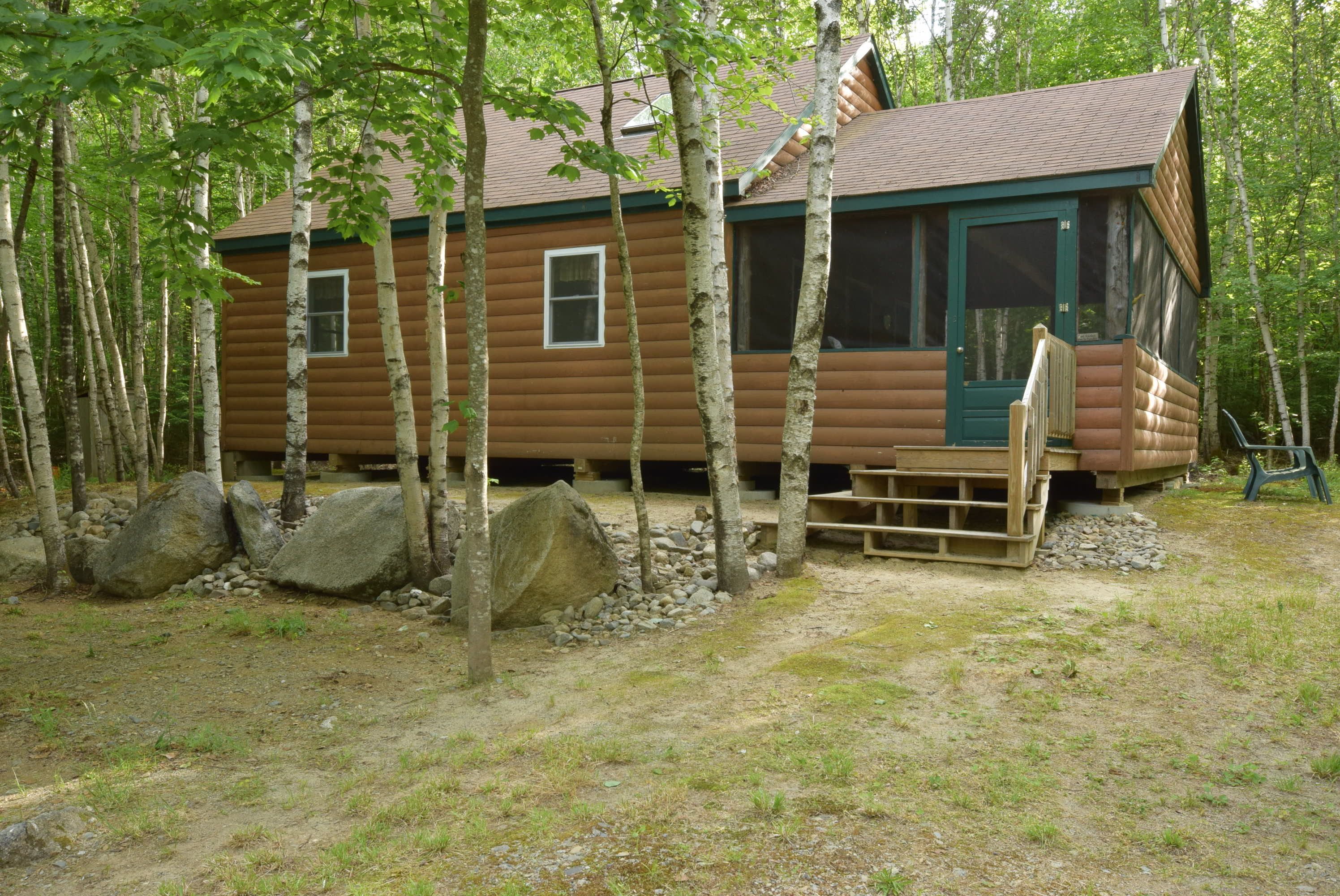 lodging sale all the rustic lodge front nicatous and season maine view cabins lakefront of vacation
