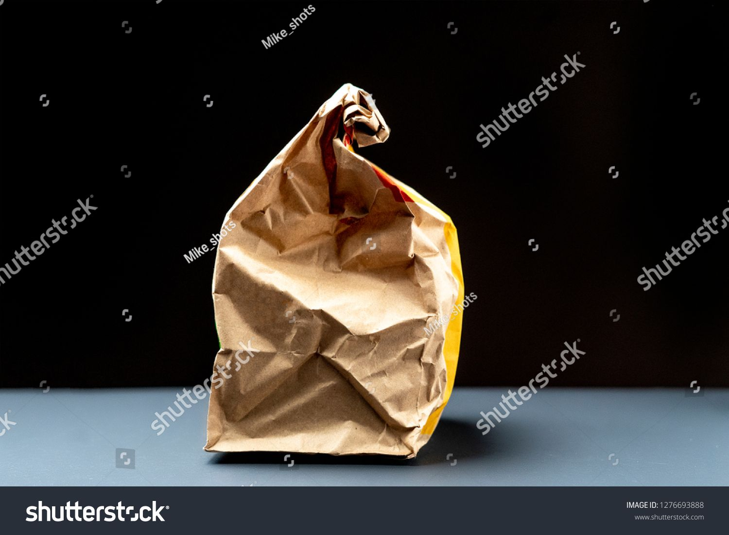 close up of paper fast food package with glass ,