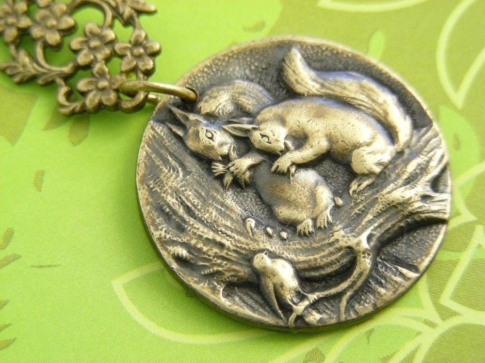 Vintage squirrel and bird pendant