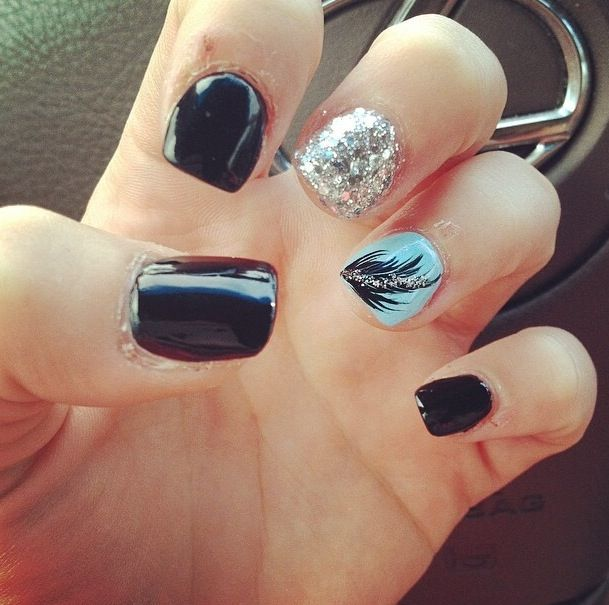 Black Acrylic Nails With Blue Feather And Silver Sparkle Accent