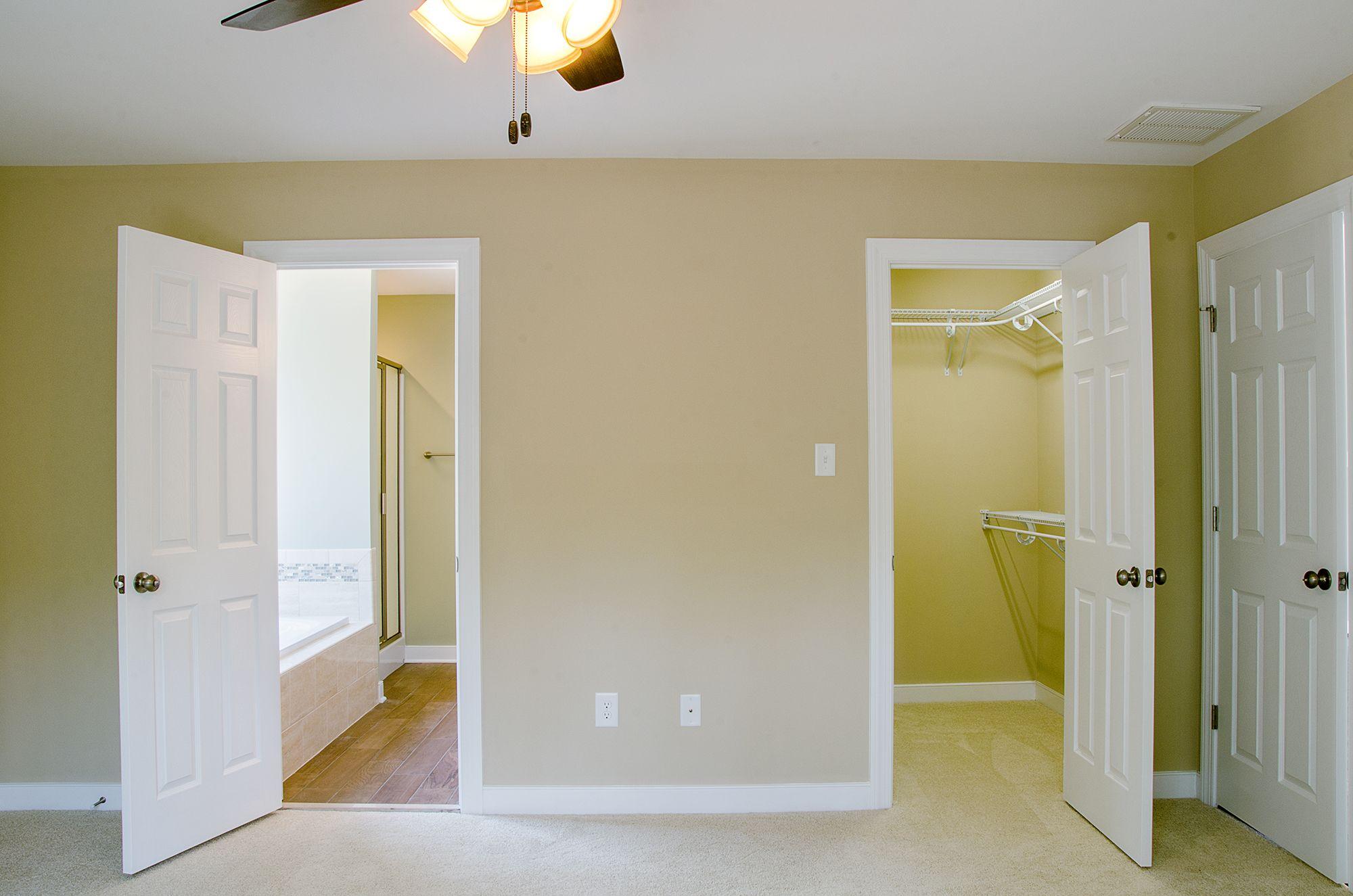 Master bedroom with walk-in closet and on-suite master bathroom ©Balducci Builders