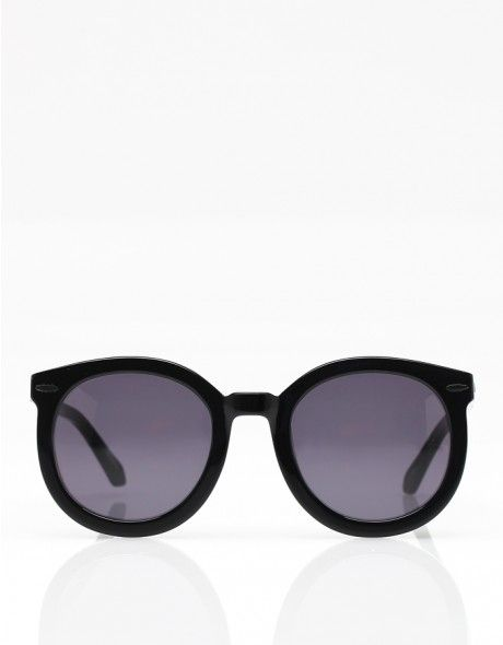d2a7683be0a Retro-inspired oversized rounded sunglasses from Karen Walker. Features  handmade acetate frame with signature arrow detail at arms
