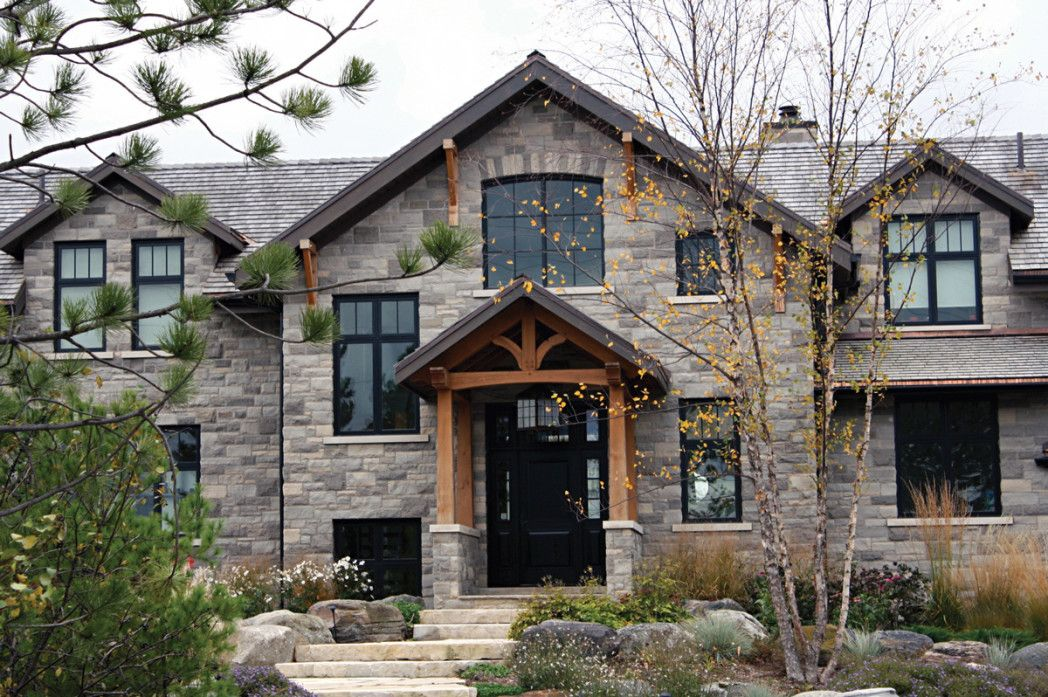 Natural stone dominated materials exterior decoration of for Wooden house exterior design