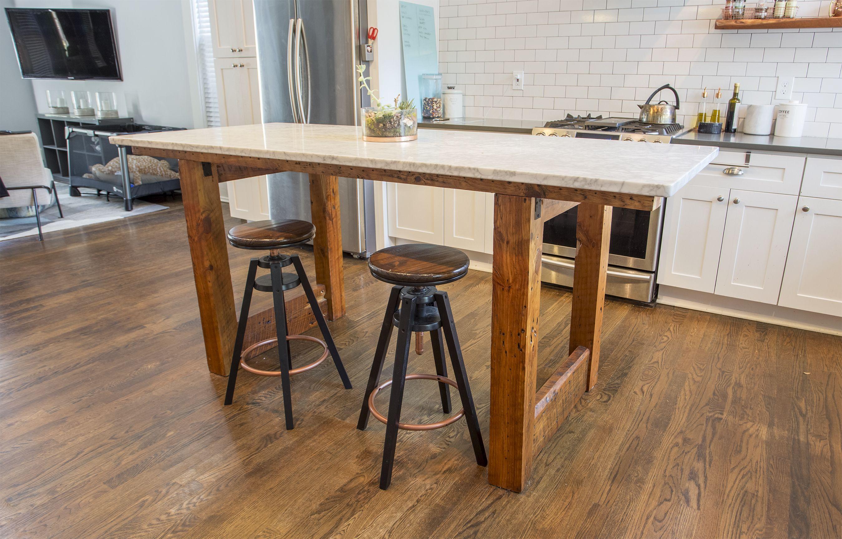 Custom reclaimed wood kitchen island with Carrerra Marble top