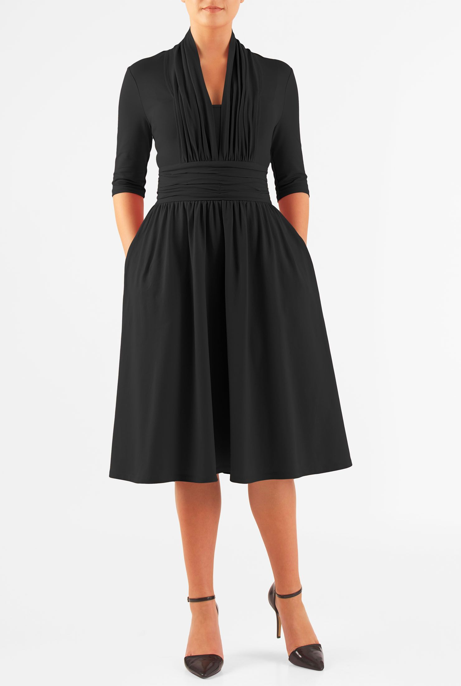 dfe04a47229c Our cotton jersey knit dress is styled with a pleated high back neck, deep  V-neck front, wide banded waist with ruched pleating and a full skirt.