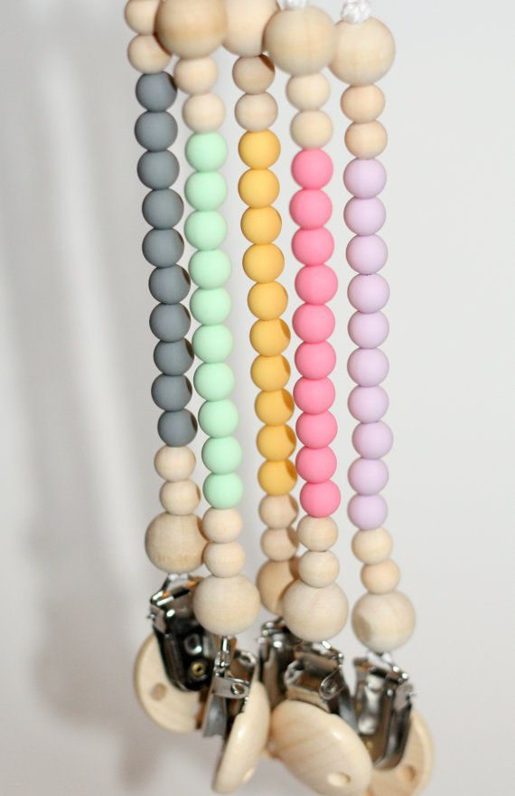 Keep your baby's pacifier or favorite toy close by using this clip made with silicone beads and wood beads. Universal design – works with many
